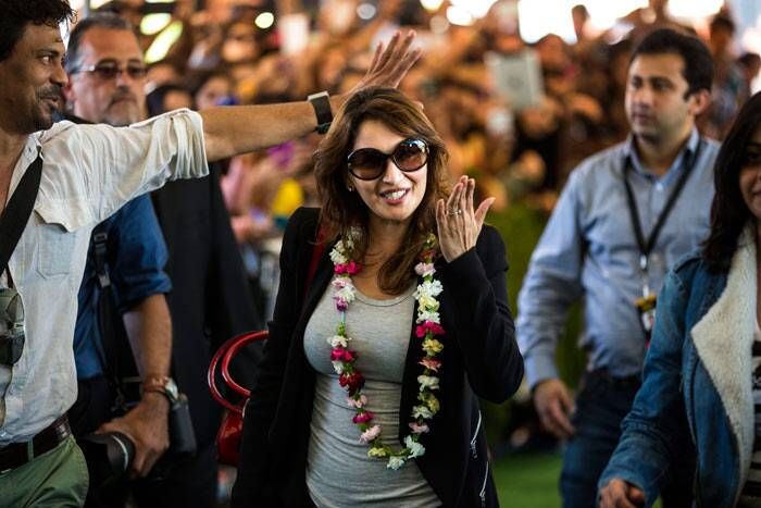 Madhuri Dixit looks happy to have finally arrived in Tampa Bay for IIFA 2014.
