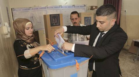 An Iraqi man casts his vote at a polling station in Baghdad, Iraq. (AP)
