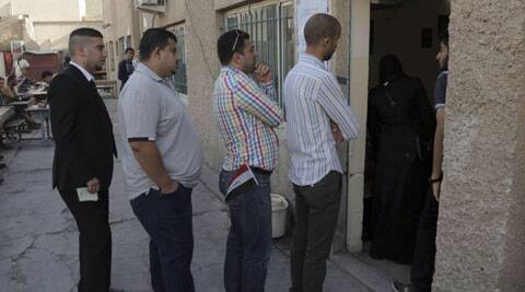 Iraqi citizens queue to vote at a polling center in Baghdad, Iraq. (AP)