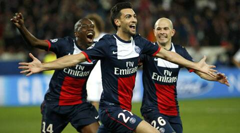 Paris St Germain's Javier Pastore celebrates with team mates after scoring the third goal for the team during their Champions League quarter-final first leg match against Chelsea in Paris. (Reuters)
