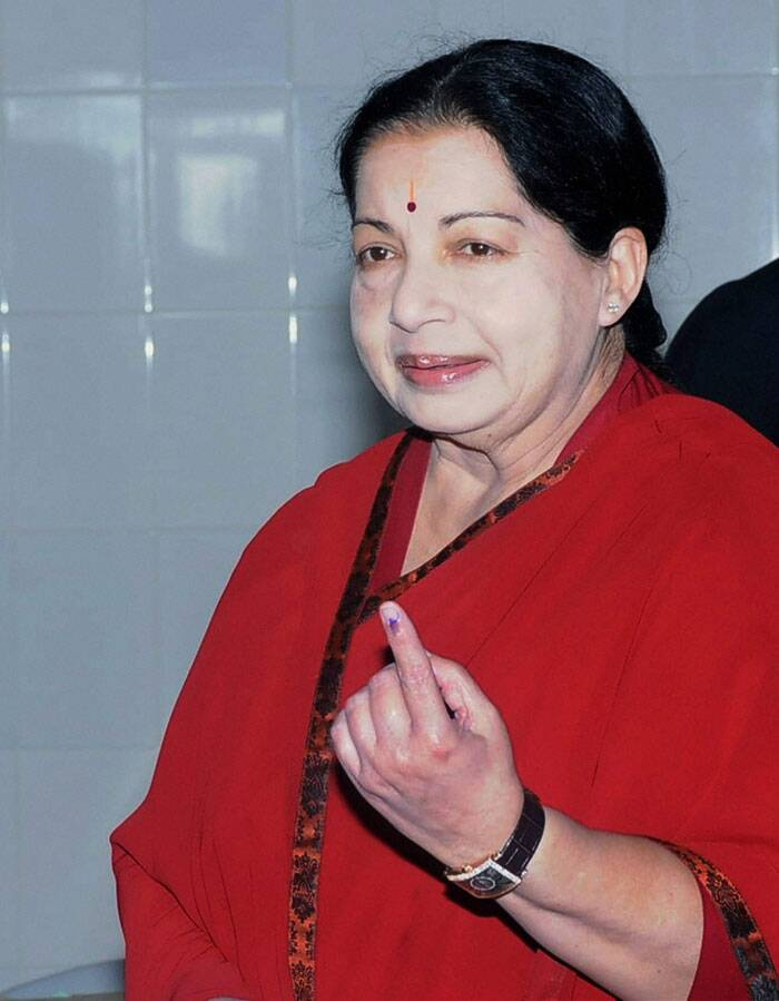 Tamil Nadu Chief Minister and AIADMK supremo Jayalalithaa shows her inked finger after casting her vote for the Lok Sabha election, in Chennai on Thursday. (PTI)