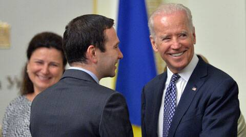 U.S. Vice President Joe Biden greets a member of the Ukrainian parliament during a meeting. (AP)