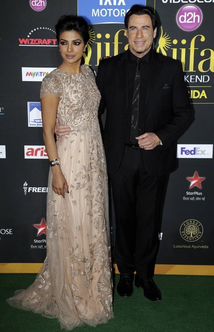 Priyanka is happy to pose with John Trovolta. (AP)