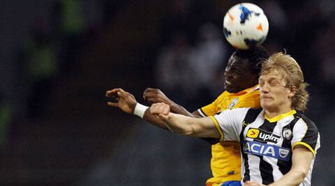 Juventus' Kwadwo Asamoah (L) jumps for the ball with Udinese's Dusan Basta during their Italian Serie A match on Monday. (Reuters)
