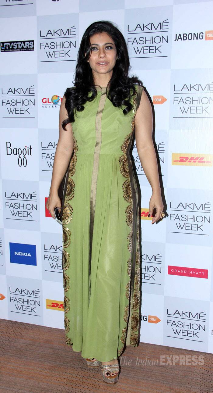 Kajol, who was quite a hit at the recently concluded Lakme fashion week, was spotted in a green silk dress by Anushka Khanna featuring a high-low hemline. (Photo: Varinder Chawla)