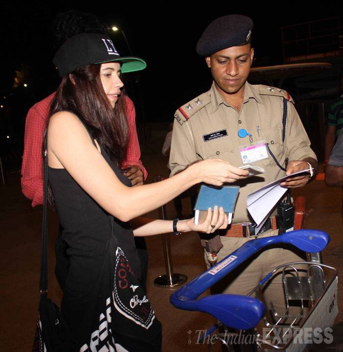 The 'Yeh Jawaani Hai Deewani' actress shows her identification to security as she prepares to go inside the airport. (Photo: Varinder Chawla)