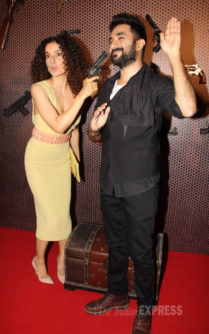 'Queen' turned 'Revolver Rani' Kangana Ranaut put her revolver to good use on co-star and onscreen lover Vir Das at the press meet of the film.  in Mumbai on Thursday (April 10). recently. She was accompanied by her co-star Vir Das. The duo strike a pose  (Photo: Varinder Chawla)