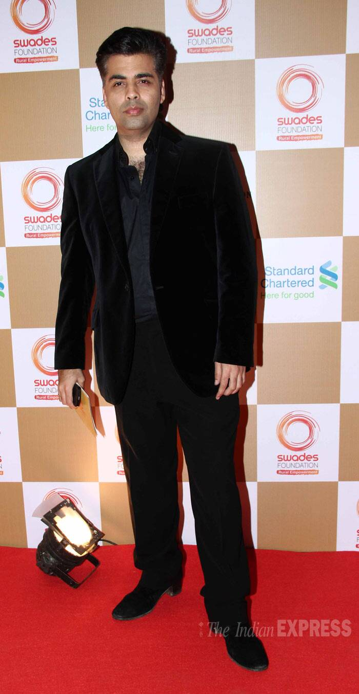 Director, produer and talk show host, Karan Johar strikes a pose on the red carpet. (Photo: Varinder Chawla)
