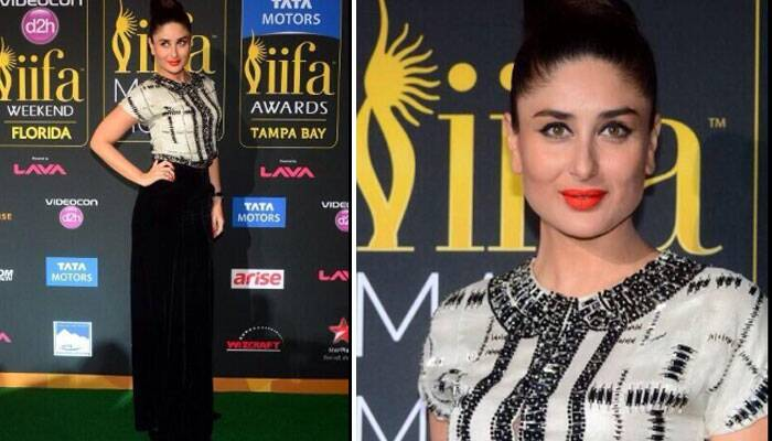 Kareena Kapoor Khan walked the green carpet looking stunning in a black Giorgio Armani skirt with a beaded white top by the same brand. A top knot and bright coral lip-colour finished off her look. (Twitter)