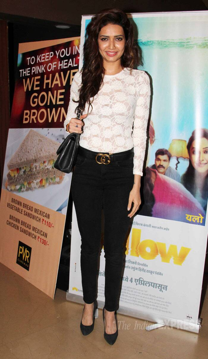 Riteish Deshmukh's 'Grand Masti' co-actor Karishma Tanna was pretty in a white lace top and black skinny jeans. (Photo: Varinder Chawla)