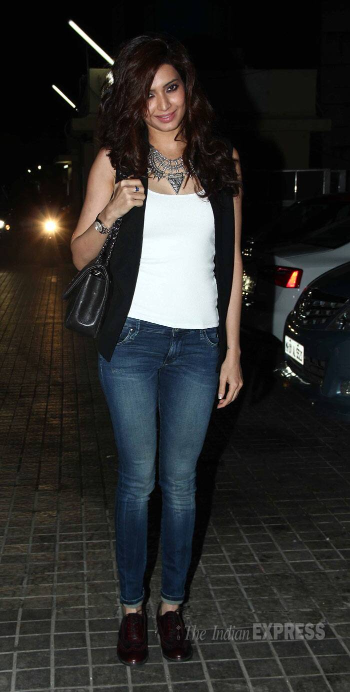 'Grand Masti' girl Karishma Tanna was chic in a white tank top with a black sleeveless jacket, skinny jeans and a statement neckpiece. (Photo: Varinder Chawla)