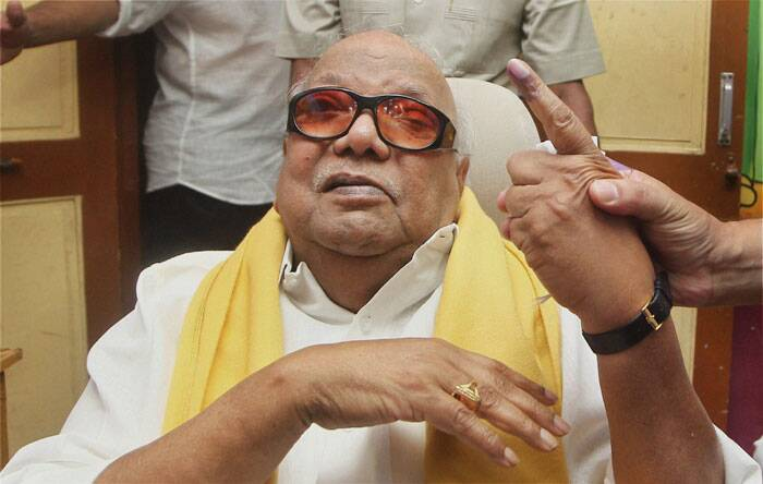 DMK Chief M Karunanidhi showing his inked finger after casting vote, in Chennai on Thursday.  (PTI)