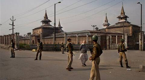 Indian paramilitary soldiers stand near the Jamia mosque during a shutdown following calls by Kashmiri rebels and separatist politicians to boycott the Indian parliamentary elections in Srinagar. (AP)