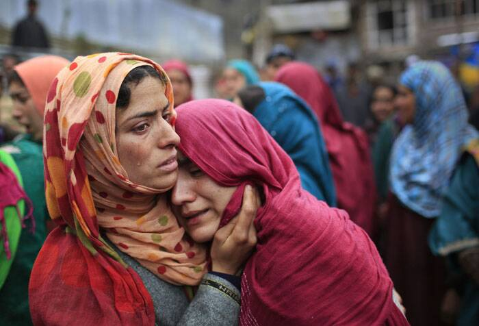 Unidentified relatives wail during the funeral procession of Zia-Ul-Haq in   Shopian on Friday. <br />Zia, a poll official was killed soon after voting for the ongoing general elections, when suspected rebels fatally shot him and wounded four others in an attack on a bus in Kashmir. (AP)