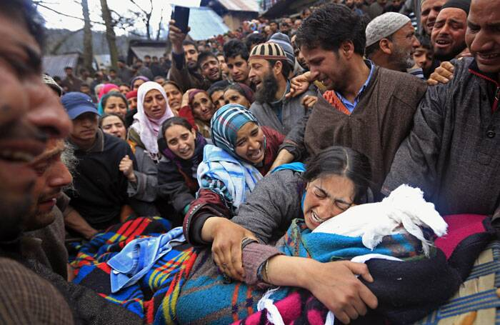 Sumaira Wani, wife of Zia-Ul-Haq mourns by the body of her husband during his funeral in Shopian. (AP)