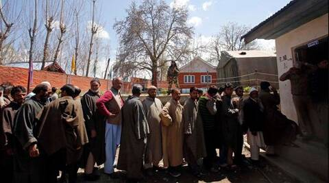 Voters stand in a queue to cast their votes at a polling station at Damhal Hanji Pora, some 85 kilometers south of Srinagar. (AP)