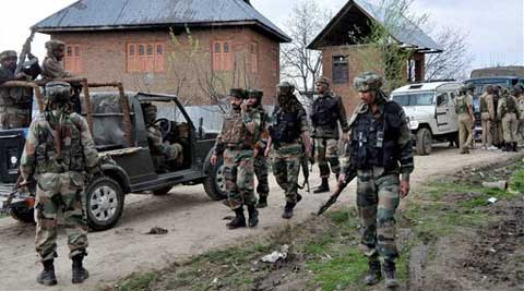 Army personnel near the house where Lashkar-e-Toiba militants were hiding during an encounter, in Shopian on Friday. (PTI)
