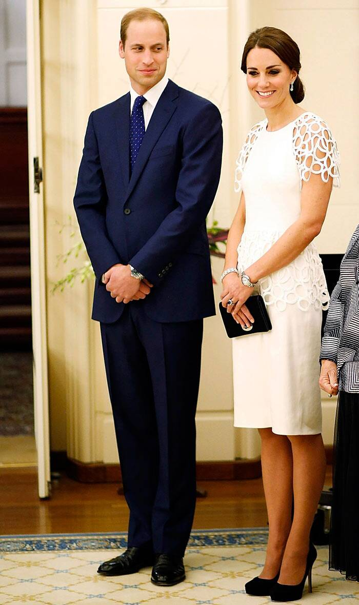 While the Duke was dapper in a dark blue suit, Kate looked stunning in a white cocktail dress by Lela Rose with a black clutch bag and matching heels. (Reuters)