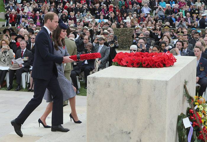The Duke and Duchess of Cambridge together place a poppie wreath on the Stone of Remembrance in front of the Australian War Memorial in Canberra. (AP)