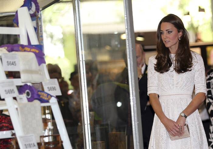 Kate looks at art works during a visit to the Royal Easter Show in Sydney. (AP)