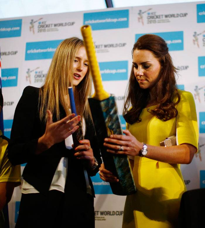 Kate receives a cricket bat from Australian women's cricket team member Ellyse Perry at the Sydney Opera House April. (Reuters)
