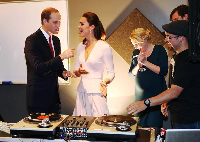 At the community centre the British royals tried their hands at the DJ deck.<br />Kate learns to play on DJ decks at the Northern Sound System in Elizabeth. (Reuters)