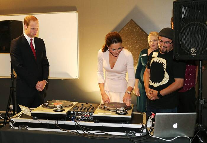 Prince William looks on as Kate Middleton is shown how to play on DJ decks at the youth community centre, The Northern Sound System in Elizabeth near Adelaide. (Reuters)