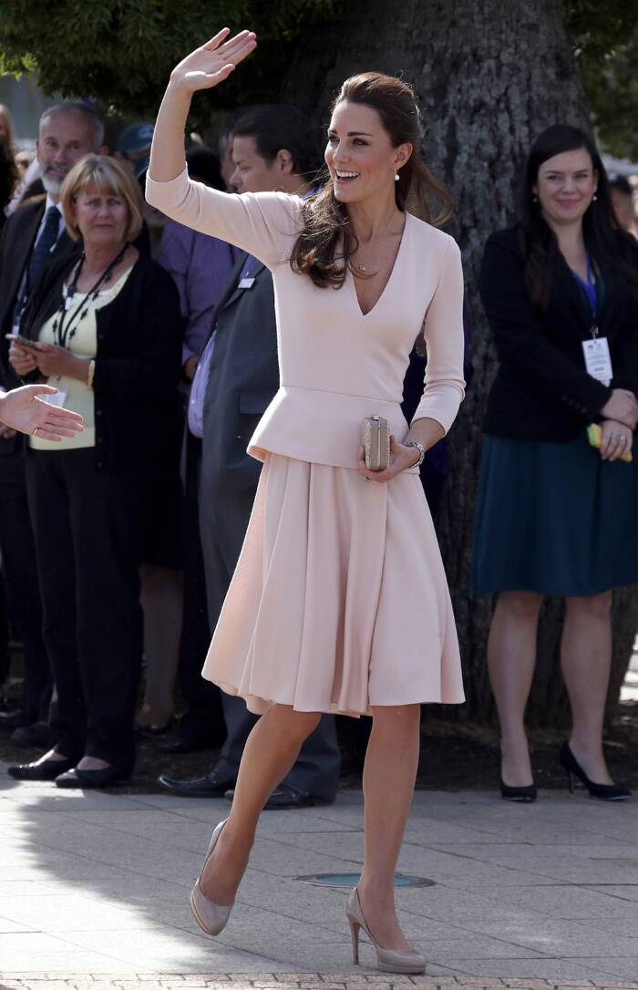 Kate Middleton was again seen in an outfit by her favourite designer Alexander McQueen. Kate looked elegant in a peach dress that she teamed with nude pumps and a box clutch. (AP)
