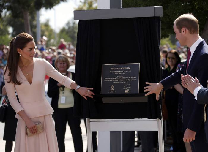 Prince William and Kate unveil a plaque naming a plaza after their son, Prince George, outside the Playford Civic Centre in Adelaide. (AP)