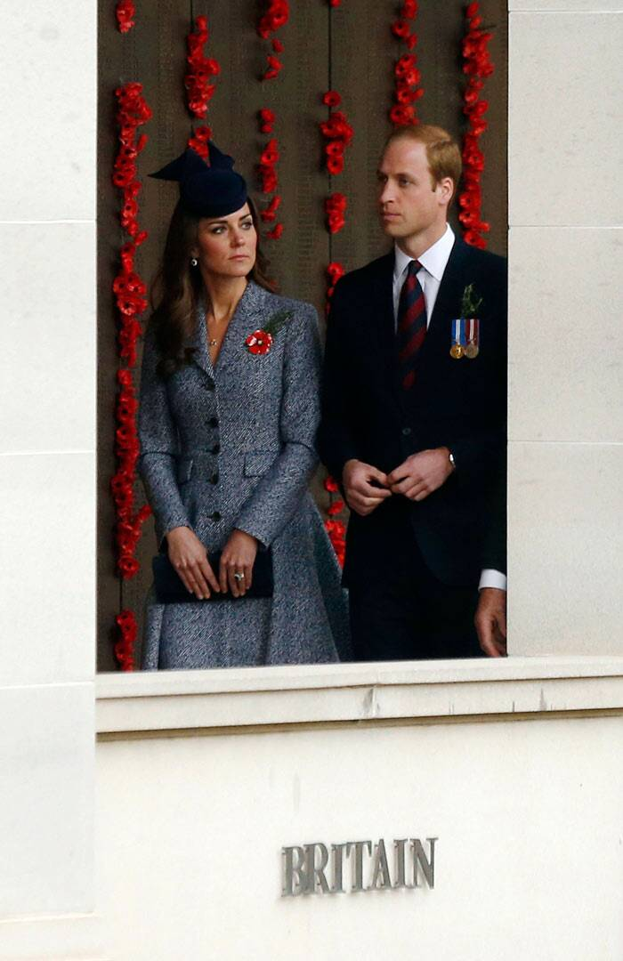 The Duchess had a poppy broach pinned to her outfit, presented to her by Emma, the wife of Corporal Ben Roberts-Smith. (AP)
