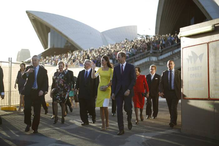 Britain's Prince William, his wife, Kate, and their baby son, George, arrived in sunny Sydney on April 16, to the cheers of thousands of fans as they kicked off their tour of Australia. <br /><br /> The coupel paused briefly to take in the views of the sun-dappled harbor and Harbour Bridge before heading inside for a welcome reception. (AP)