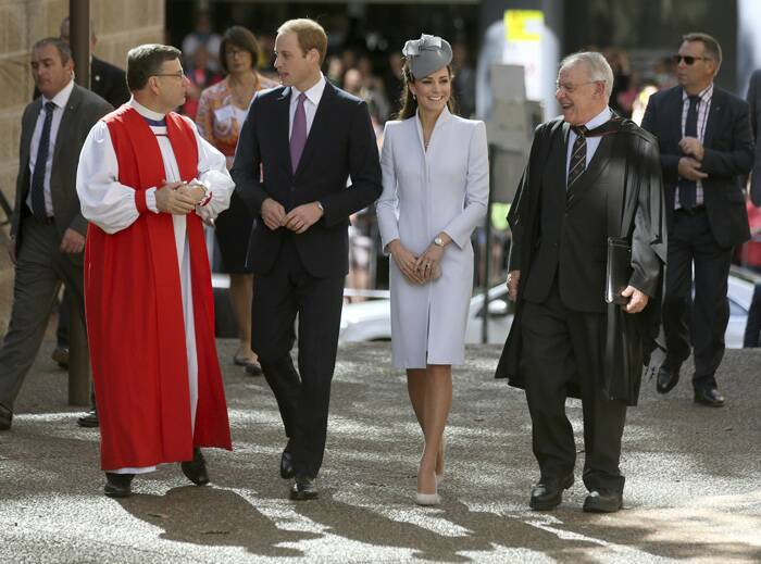 Also in attendance were Prime Minister Tony Abbott, his wife Margie, and hundreds of parishioners.<br /><br />Prince William, Kate Middleton walk with The Most Reverend Glenn Davies, Archbishop of Sydney and The Very Reverend Phillip Jensen, Dean of Sydney, as they arrive at St. Andrew's Cathedral for Easter Sunday church services in Sydney. (AP)