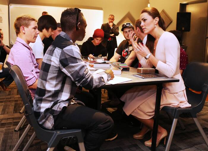 Kate speaks to young man during a visit to the youth community center. (AP)