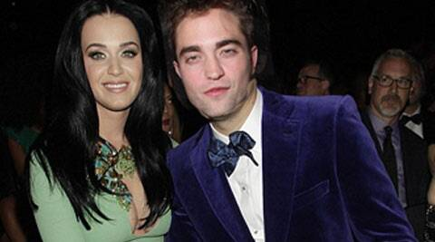 Singer Katy Perry and actor Robert Pattinson's friends want them to date each other. The 29-year-old 'Roar' hitmaker, who recently broke up with singer John Mayer, was recently seen spending time with Pattinson, 27, at the Coachella valley music and arts festival in California, reported Contactmusic.