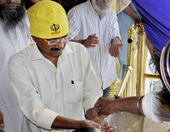 AAP convener Arvind Kejriwal receiving 'parsad' during a visit to the Golden Temple in Amritsar on Friday. (PTI)