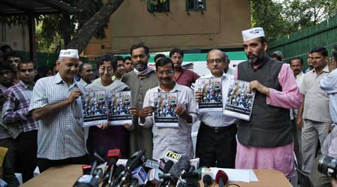AAP chief Arvind Kejriwal accompanied by his other party members, hold their party's manifesto ahead of the general elections in New Delhi April 3, 2014. (PTI)