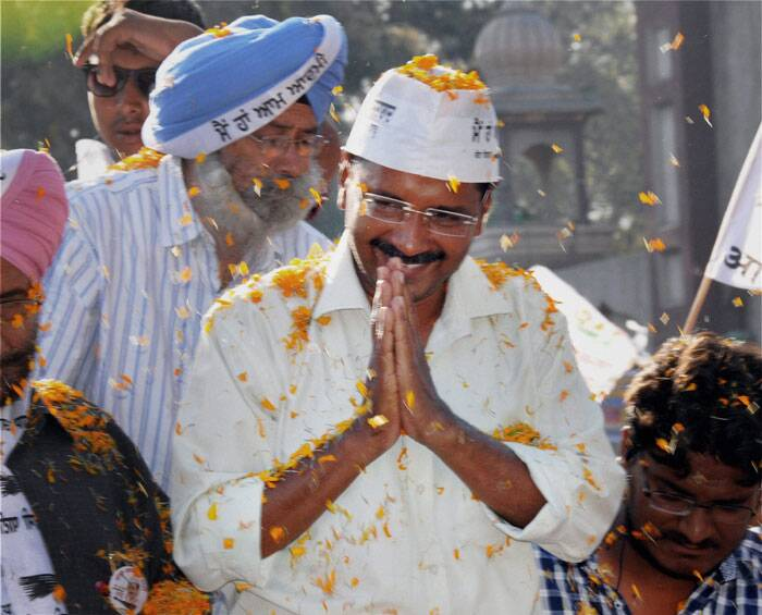 AAP convener Arvind Kejriwal campaigns during an election roadshow in support of party candidate Daljit Singh in Amritsar on Friday. (PTI)
