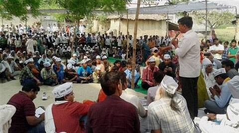 Arvind Kejriwal speaks during a public meeting in a village as part of his election campaign in Varanasi on Thursday. (PTI Photo)