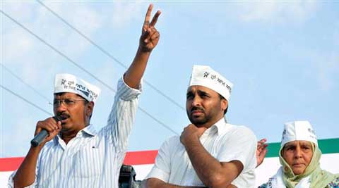 AAP Party Chief Arvind Kejriwal campaigns with party candidate from Sangrur Bhagwant Mann, on Sunday. (PTI)