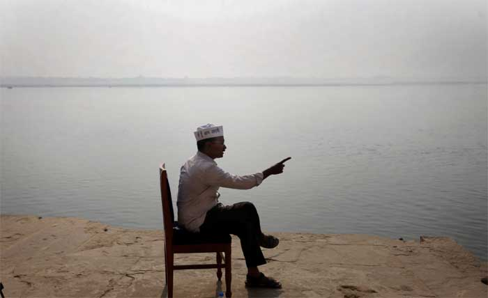 AAP Chief Arvind Kejriwal giving an interview to a TV news channel along the banks of Ganga near Tulsi Ghat on Wednesday morning. (Express Photo: Oinam Anand.)