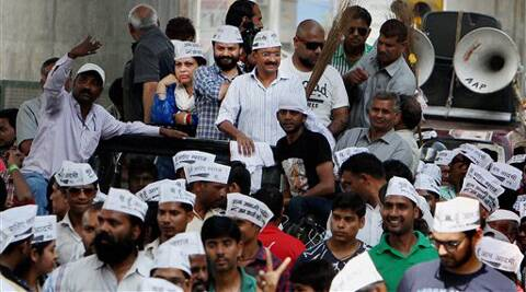 AAP convener Arvind Kejriwal during his election road show at Patel Nagar in New Delhi on Sunday. (PTI)