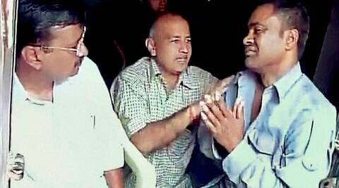 Arvind Kejriwal along with Manish Sisodia, meets the auto-rickshaw driver Lali on Wednesday who slapped him while he was campaigning in Sultanpuri in northwest Delh on Tuesday. (PTI)