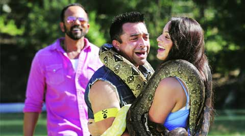 Host Rohit Shetty looks on as Ajaz Khan and Deana Uppal perform a stunt