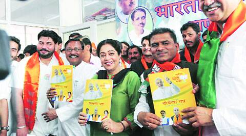 BJP candidate Kirron Kher releases the party manifesto at BJP's Sector 33 office,  on Saturday. (Jasbir Malhi)