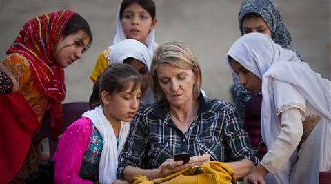 Photographer Anja Niedringhaus, was killed on Friday, April 4, 2014 when an Afghan policeman opened fire while they were sitting in their car in eastern Afghanistan. (AP)