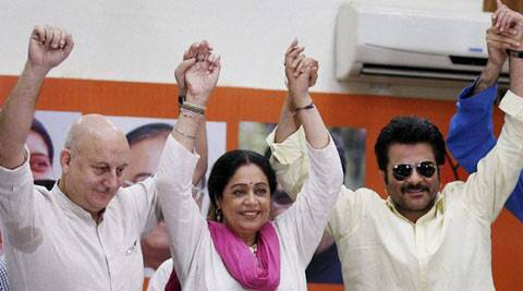 Bollywood actor Anupam Kher, BJP candidate Kirron Kher and Bollywood actor Anil Kapoor during a press conference in Chandigarh on Sunday. (PTI)