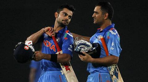 India's Virat Kohli and captain MS Dhoni (R) come off the field after India won the semi-final match against South Africa on Friday. (Reuters)
