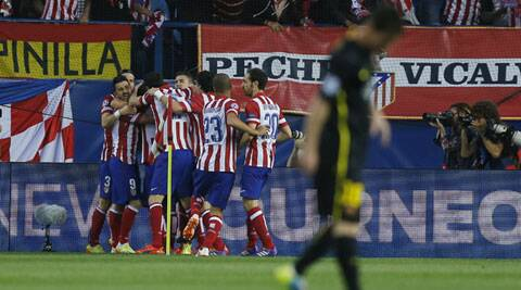 Atletico's Koke, obscured, celebrates his goal with team mates during the Champions League quarterfinal second leg match between Atletico Madrid and Barcelona on Wednesday. (AP)