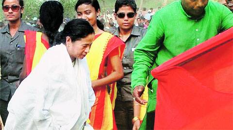 Mamata on way to address an election rally in Bankura, Tuesday. PTI