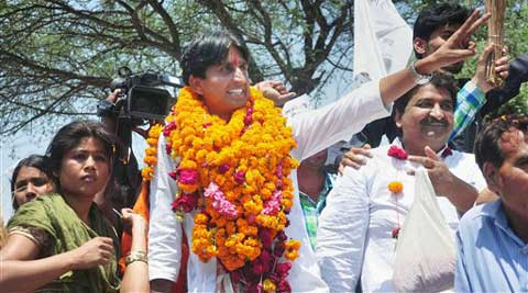 AAP candidate from Amethi Kumar Vishwas waves to supporters on the way to file his nomination papers for Amethi parliamentary seat, in Amethi on Saturday. (PTI)